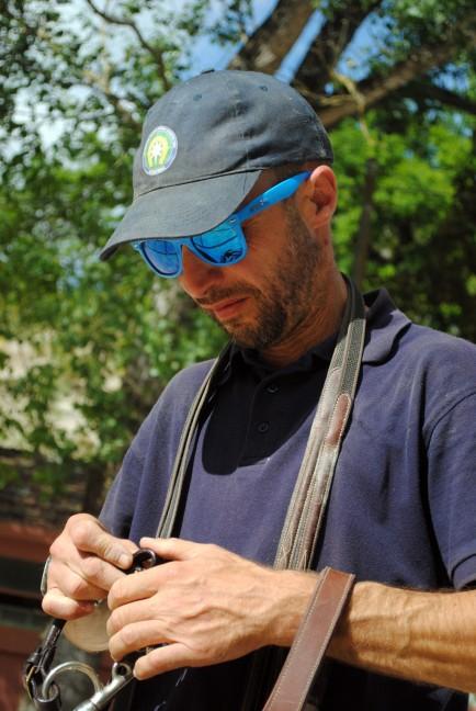 Luca Panunzi prepares a horse bridle.