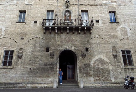 Marco Valeri stands in the doorway of City Hall in Cagli, Italy.