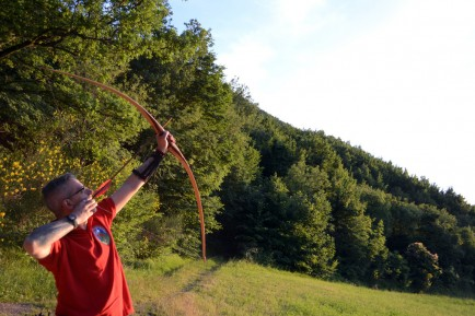 Stefano Barzotti takes aim for the sun in an archers' stance.